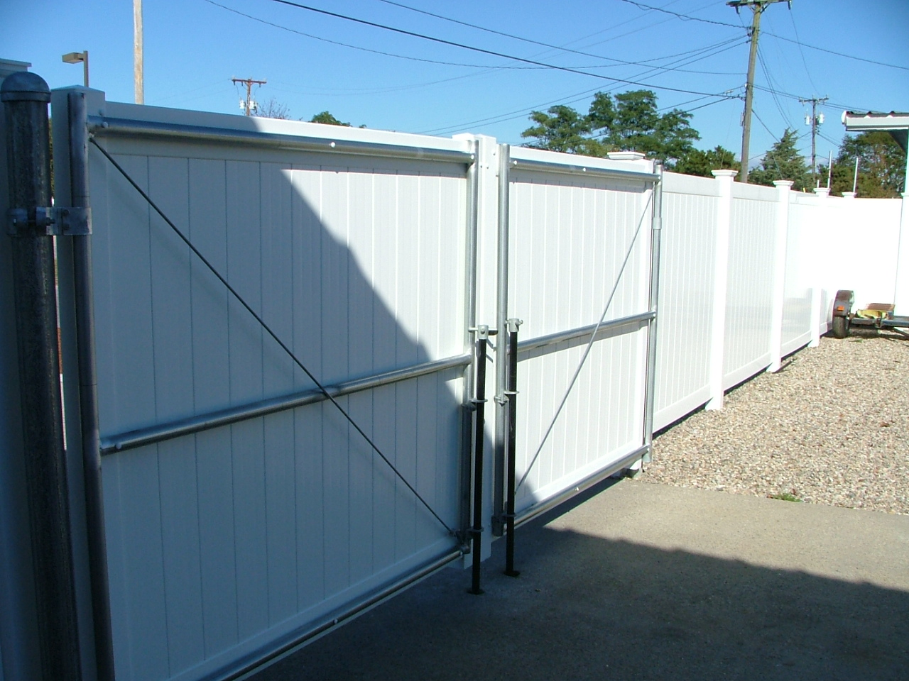 Vinyl gate with steel frame