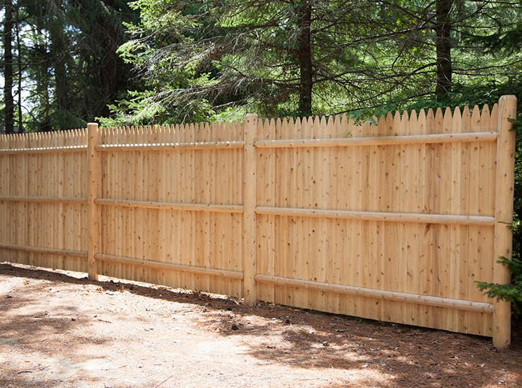 Wood stockade fence