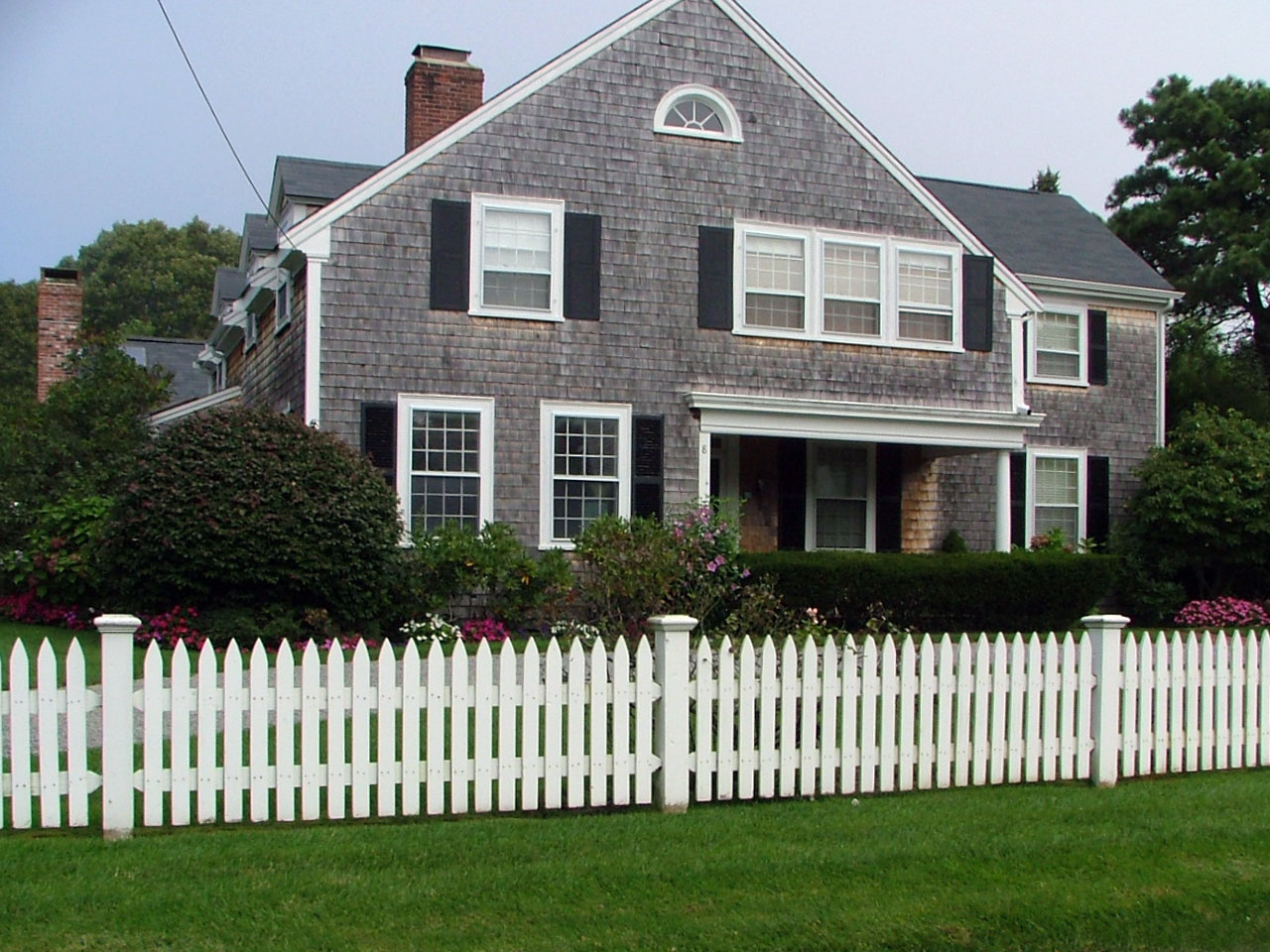 Wood picket fence cape cod