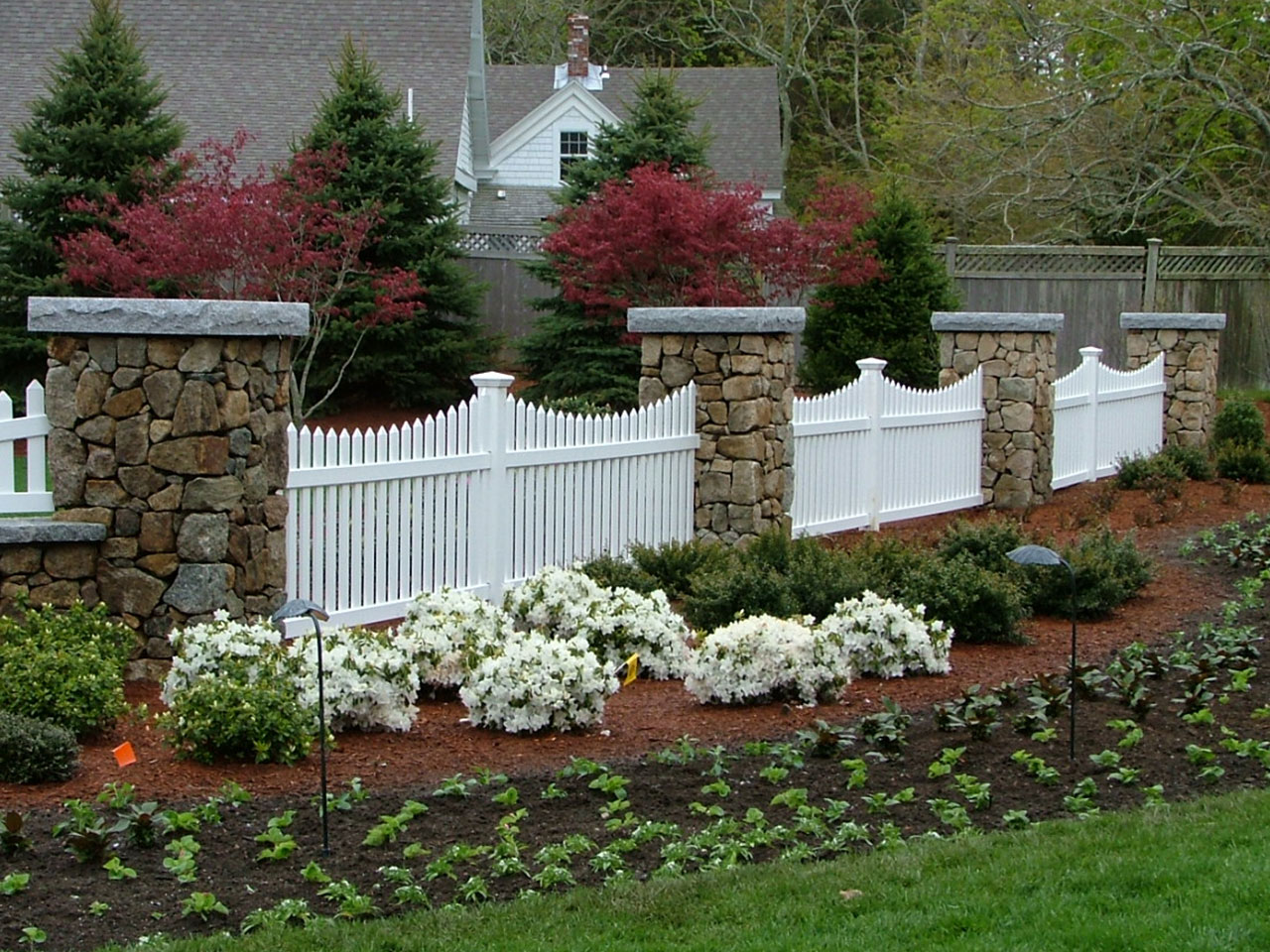 Vinyl spaced baluster fence Cape Cod